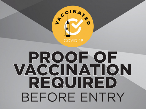 "Proof of vaccination required before entry. This is a yard sign that has a grey background. The top has a yellow circle with a tick and the sentence ""Vaccinated"""